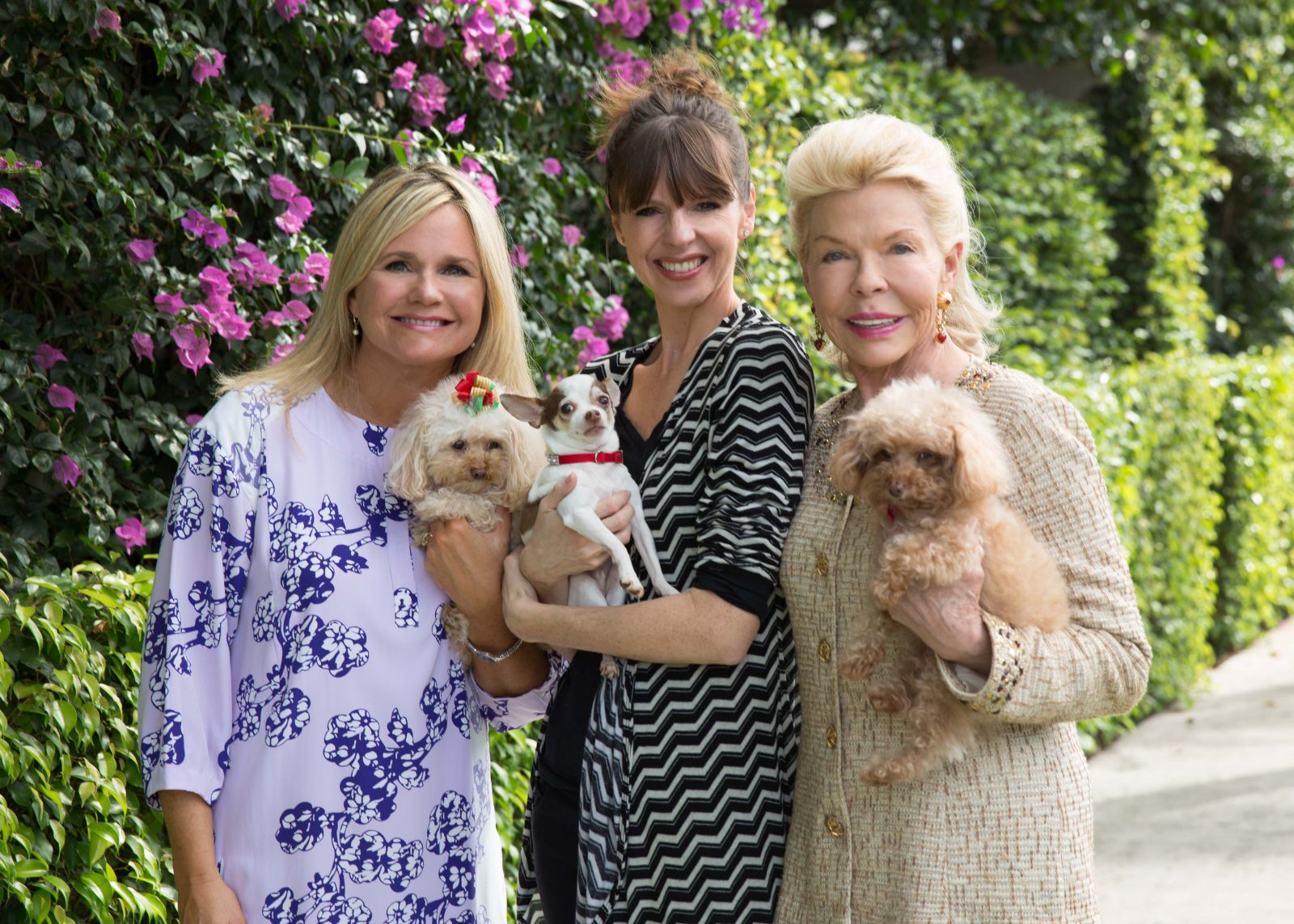 Lois Pope and friends with their dogs